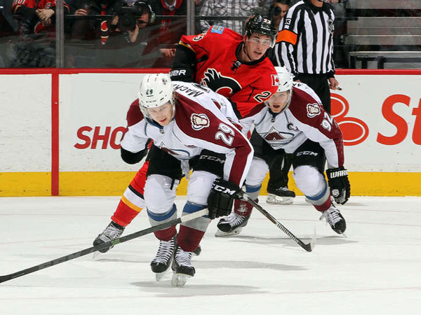 Flames tie game late, top Avalanche in OT