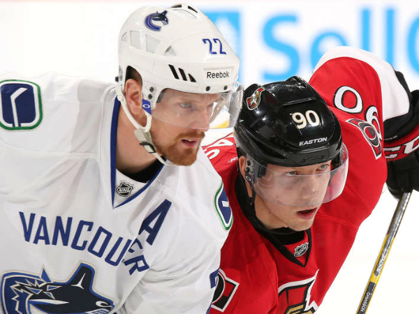 Senators rally, top Canucks in OT to end skid