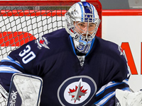 Hellebuyck helps Jets hold off Canucks